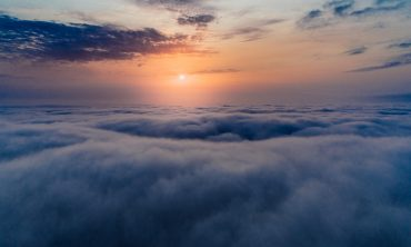 sun shines above clouds