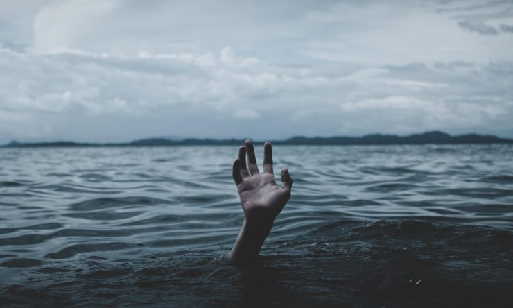 sinking-person-begging-hand-above-water