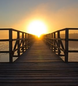 jetty-with-wood-fences-on-backside-and-in-the-middle-the-sunset